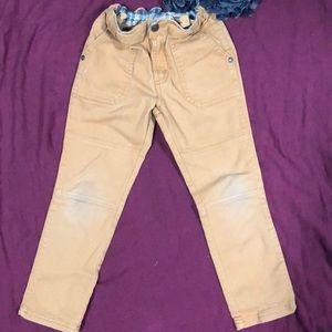 Khaki colored cargo style pant.